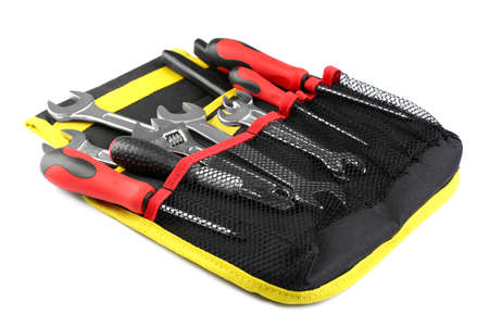 Bag with different construction tools on white background