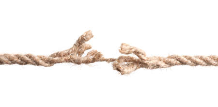 Rupture of cotton rope on white background 写真素材
