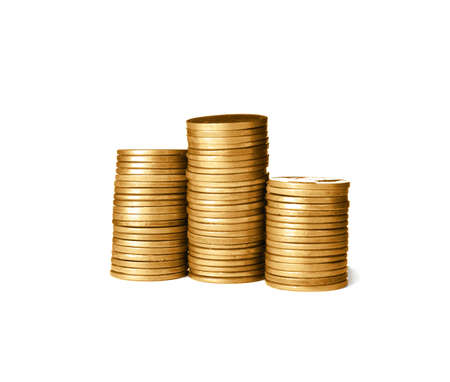 Stacks of shiny coins on white background