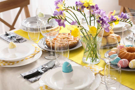 Festive Easter table setting with traditional meal at home Banco de Imagens