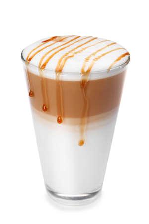 Glass of tasty caramel macchiato on white background
