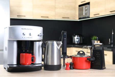 Set with modern domestic appliances in kitchen Foto de archivo