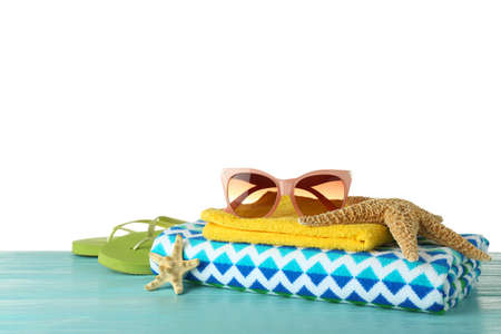 Set of beach accessories on table against white background. Space for text