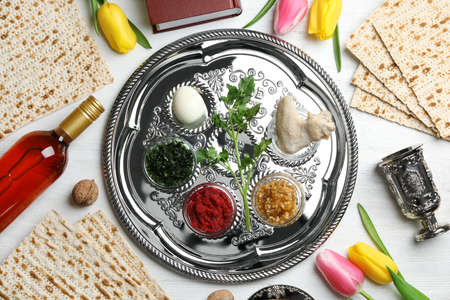 Flat lay composition with symbolic Passover (Pesach) items and meal on color background Stock Photo