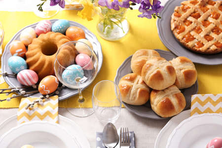 Festive Easter table setting with traditional meal, above view Stock Photo
