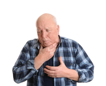 Senior man suffering from cough on white background