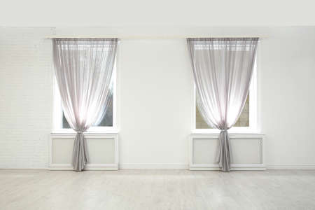 Modern windows with curtains in room. Home interior