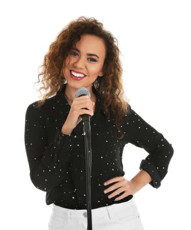 Curly African-American woman posing with microphone on white background Stock Photo