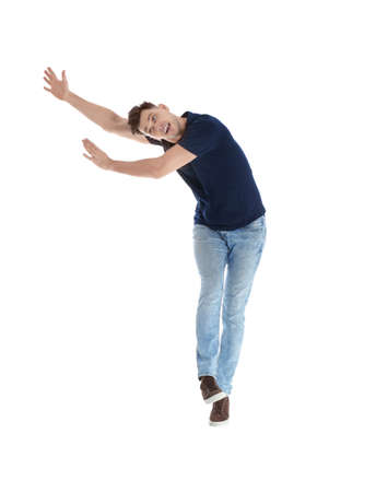 Emotional man in casual clothes posing on white background