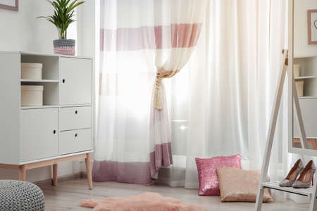 Modern furniture and window curtains in stylish room interior