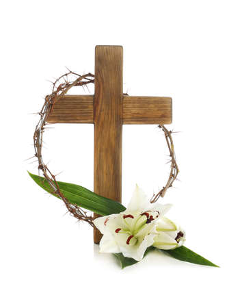 Wooden cross, crown of thorns and blossom lilies on white background