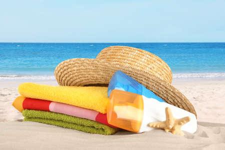 Set of beach accessories on sandy sea coast