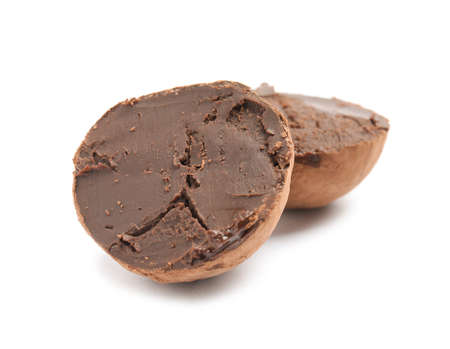 Delicious raw chocolate truffle on white background
