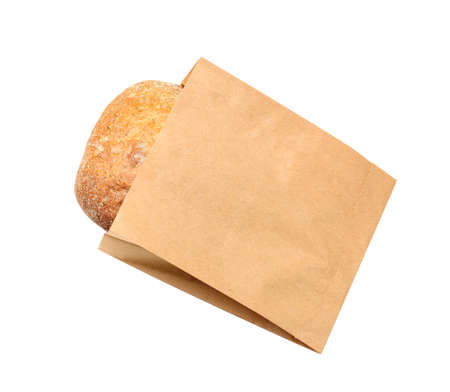 Paper bag with bread on white background, top view. Space for design