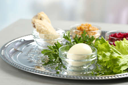 Traditional Passover (Pesach) Seder plate with symbolic meal on table indoors, space for text