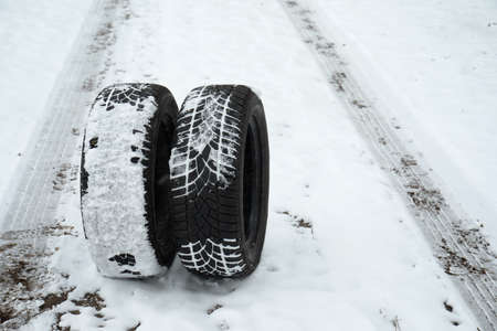 New winter tires on fresh snow. Space for text