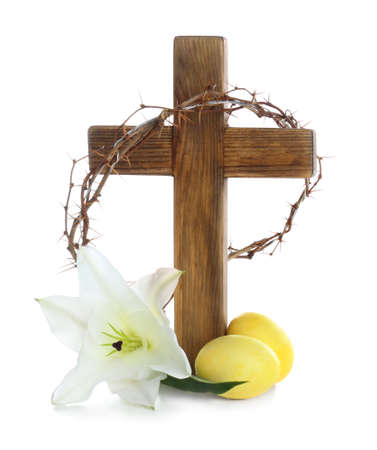 Wooden cross, crown of thorns, Easter eggs and blossom lily on white background