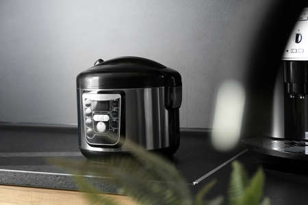 Modern multi cooker in kitchen. Domestic appliance Stock Photo