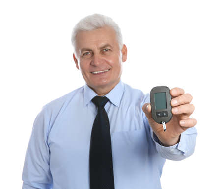 Senior man holding glucometer on white background. Diabetes control