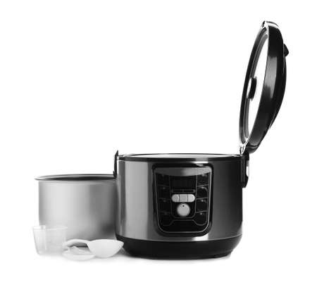 Disassembled electric multi cooker with accessories on white background