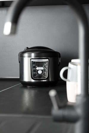 Modern multi cooker in kitchen. Domestic appliance 스톡 콘텐츠