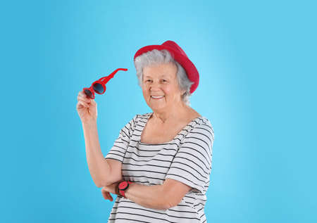 Portrait of cool grandmother on color background Stock fotó