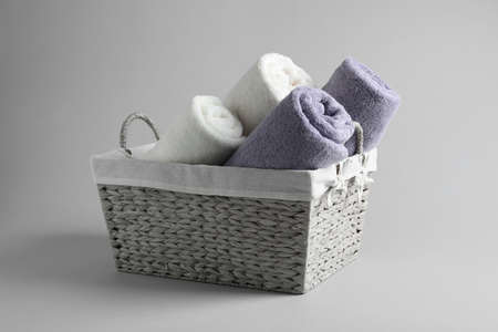 Basket of fresh towels on grey background 写真素材