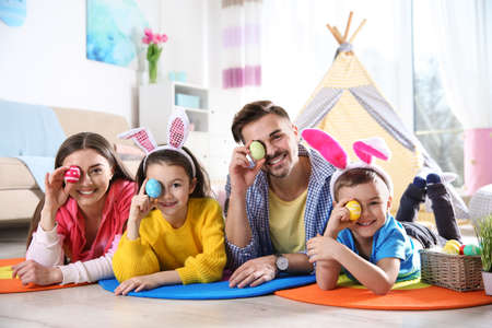 Happy family spending time together during Easter holiday at home Stock Photo - 120157295