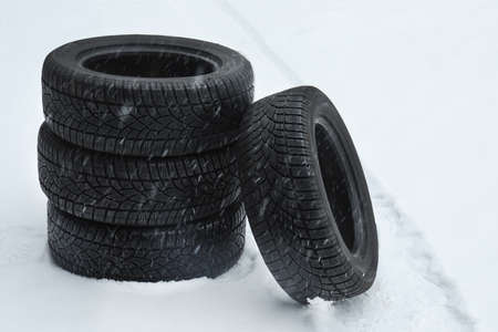 New winter tires on fresh snow outdoors