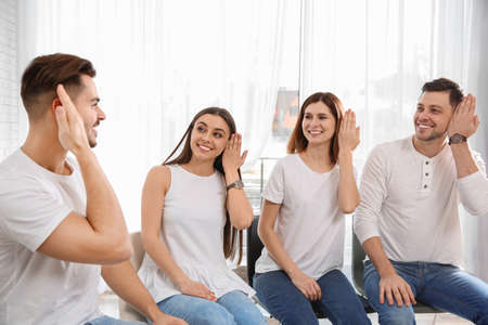 Group of young people learning sign language with teacher indoors Stock Photo