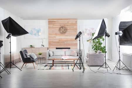 Professional photo studio equipment prepared for shooting living room interior Imagens