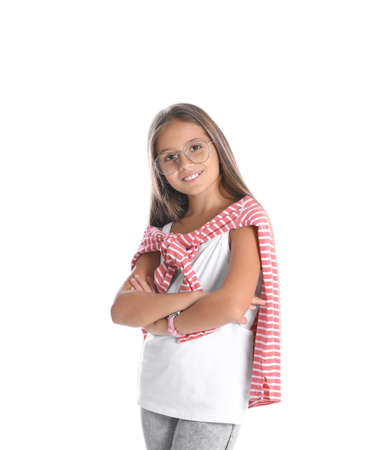 Pretty preteen girl posing against white background