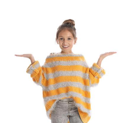 Pretty emotional preteen girl posing against white background