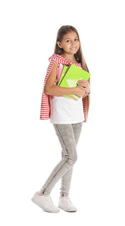 Pretty preteen girl with notebooks against white background