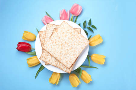 Composition with matzo and flowers on color background, top view. Passover (Pesach) Seder Stock Photo