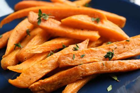Closeup view of plate with sweet potato fries Stok Fotoğraf