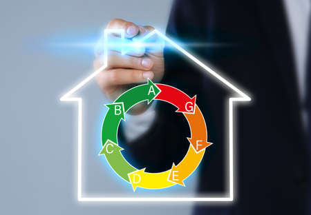 Businessman pointing on virtual icon against color background, closeup. Energy efficiency concept