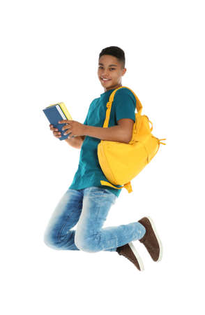 African-American teenager boy with books on white background Фото со стока