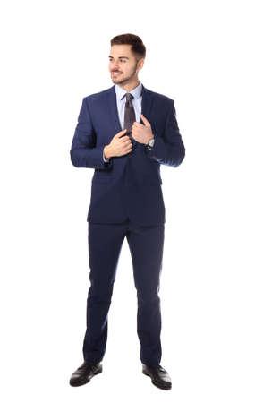 Retrato de cuerpo entero del empresario posando sobre fondo blanco. Foto de archivo