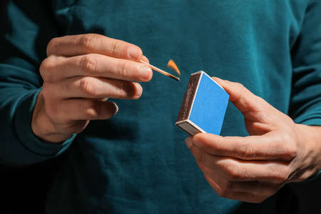 Man with box of matches, closeup of hands Imagens