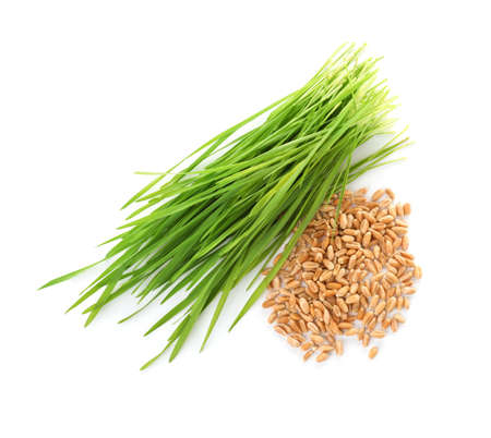 Composition with wheat grass and seeds on white background, top view