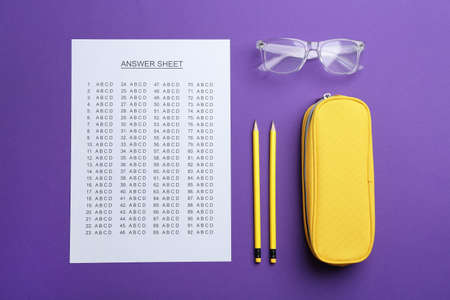Flat lay composition with answer sheet on color background