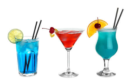 Tasty refreshing cocktails in glasses on white background