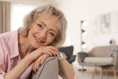 Portrait of mature woman in living room