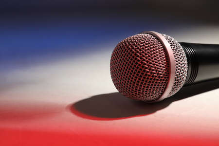 Modern microphone on color background, closeup. Space for text