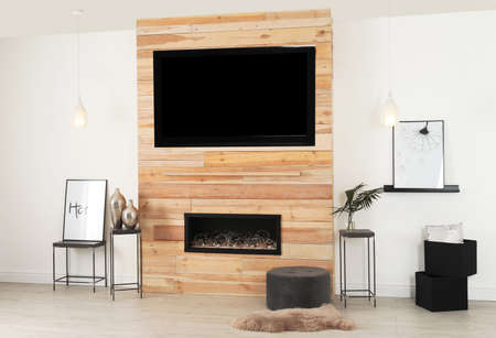Living room interior with decorative fireplace in wooden wall