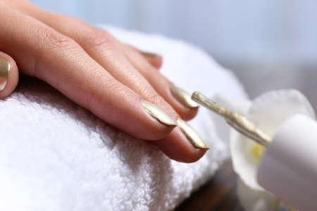 Woman getting manicure in salon, closeup. Nail polish trends
