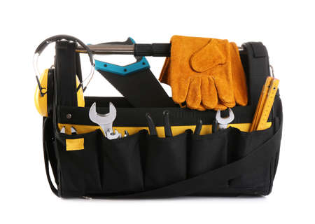 Organizer bag with construction tools and safety equipment on white background Stock Photo
