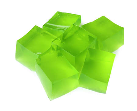 Heap of green jelly cubes on white background