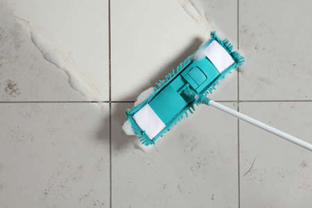 Washing of dirty floor with mop, top view. Space for text